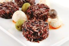 Mozarella cheese and dark rice Stock Image