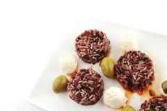 Mozarella cheese and dark rice Royalty Free Stock Photography