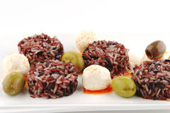 Mozarella cheese and dark rice Royalty Free Stock Photos