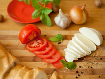 Mozarella cheese with fresh tomatoes and baguette Stock Image