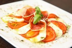 Mozarella and tomatos Stock Images
