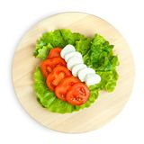 Mozarellina cheese with tomato and salad. Mozarella with tomato on  wood board Stock Photography