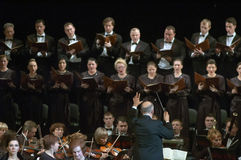 Mozart's Requiem. DNEPROPETROVSK, UKRAINE - NOVEMBER 23: Members of the Choir and Symphonic Orchestra of the State Opera and Ballet Theatre perform Mozart's Stock Image