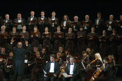 Mozart's Requiem. DNEPROPETROVSK, UKRAINE - NOVEMBER 23: Members of the Choir and Symphonic Orchestra of the State Opera and Ballet Theatre perform Mozart's Royalty Free Stock Photography