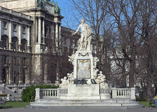 Mozart Statue in front of the Museum of Ethnology in park Burggarten. Vienna, Austria. The Mozart statue was created in 1896 by the Austrian sculptor Viktor Royalty Free Stock Images
