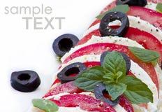 Mozzarela con las aceitunas Imagen de archivo libre de regalías