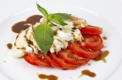 Mozzarele com tomates Imagens de Stock
