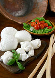Mozzarella. A fresh italian cheese with tomatoes and basil Stock Image