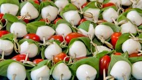 Mozzarella ball tomato basil appetizers Royalty Free Stock Images
