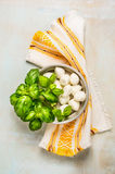 Mozzarella balls with basil on blue wooden background with towel Royalty Free Stock Photos