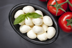 Mozzarella Balls and Vine Tomatoes Royalty Free Stock Images