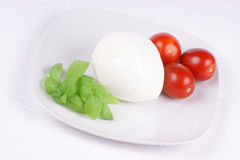 Mozzarella, basil and cherry tomatoes Royalty Free Stock Images