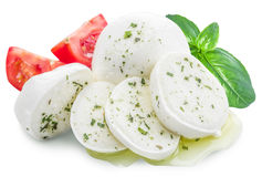 Mozzarella, basil and tomatoes. Clipping paths. Mozzarella, basil and tomatoes. File contains clipping paths Stock Images