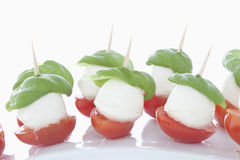 Mozzarella with Basil on white background, close up Stock Photography