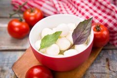 Mozzarella and basilicas Stock Photo