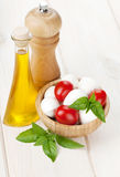 Mozzarella cheese with cherry tomatoes and basil Royalty Free Stock Images