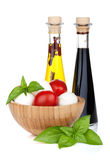 Mozzarella cheese with cherry tomatoes and basil Stock Photos