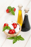 Mozzarella cheese with cherry tomatoes and basil Stock Photography