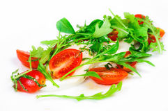 Mozzarella cheese with cherry tomatoes and salad. Mozarella cheese with cutted cherry tomatoes, some salad and oil. Close up, isolated on white background Royalty Free Stock Photo