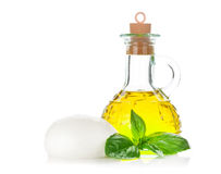 Mozzarella cheese, olive oil and basil Royalty Free Stock Image