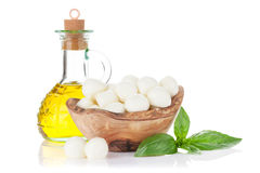 Mozzarella cheese, olive oil and basil Stock Image
