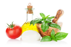 Mozzarella cheese, olive oil, tomato and basil Stock Image
