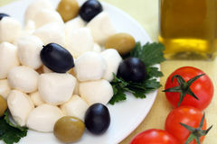 Mozzarella cheese and olives Royalty Free Stock Photos
