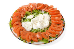 Mozzarella cheese and tomato. Mozzarella chesse tomato and rocket on a plate stock image