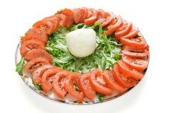 Mozzarella cheese and tomato. Mozzarella chesse tomato and rocket on a plate Royalty Free Stock Photo
