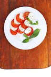 Mozzarella cheese tomato and basil Stock Images