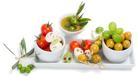 Mozzarella cheese with tomatoes,  olives and spices Royalty Free Stock Images