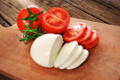 Mozzarella cheese with tomatoes and rosemary. Royalty Free Stock Images