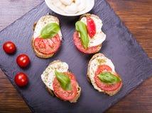 Mozzarella cheese and tomatoes Stock Photos