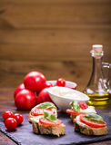 Mozzarella cheese and tomatoes Stock Images