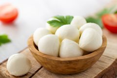 Mozzarella cheese in wooden bowl. Rustic style royalty free stock photography