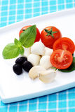 Mozzarella and cherry tomatoes Stock Images