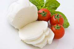Mozzarella, cherry tomatoes and basil Stock Photos