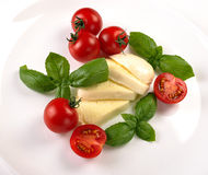 Mozzarella cherry tomatoes basil Royalty Free Stock Image
