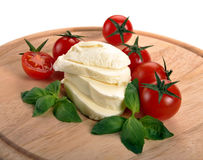 Mozzarella cherry tomatoes basil Royalty Free Stock Photo