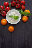 Mozzarella, cherry tomatoes and basil Stock Photo