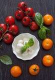 Mozzarella, cherry tomatoes and basil Stock Image