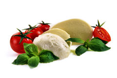 Mozzarella cherry tomatoes basil Royalty Free Stock Images