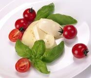 Mozzarella cherry tomatoes basil Royalty Free Stock Photography