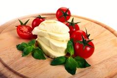 Mozzarella cherry tomatoes basil Stock Photography
