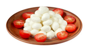 Mozzarella with cherry tomatoes on plate isolated on white backg Royalty Free Stock Image