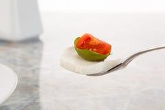 Mozzarella con los tomates y la albahaca Fotografía de archivo libre de regalías