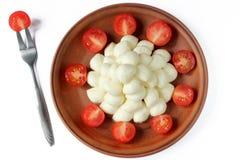 Mozzarella de bébé et tomates-cerises Photographie stock libre de droits