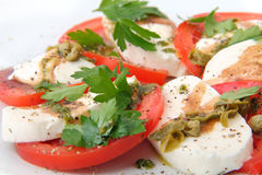 Mozzarella with fresh basil and capers sauce Stock Images