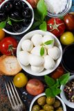 Mozzarella, fresh ingredients for the salad and bread, vertical Stock Image