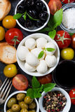 mozzarella, fresh ingredients for the salad and bread, vertical Royalty Free Stock Photos